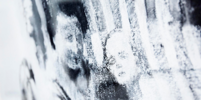 A close up detail of a artwork called 'Ahlbeck 1932' by Judith Tucker. The image shows a close up of the faces of a mother and her daughter. The drawing has been done in such a way so that there aren't fine details.